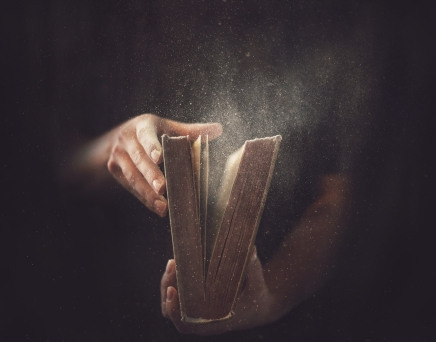 holding-an-open-book-with-dust-coming-out_rQZ9GJfg0.jpg